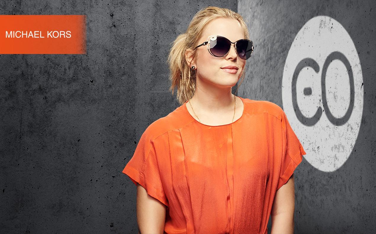 Female model wearing Michael Kors sunglasses for women