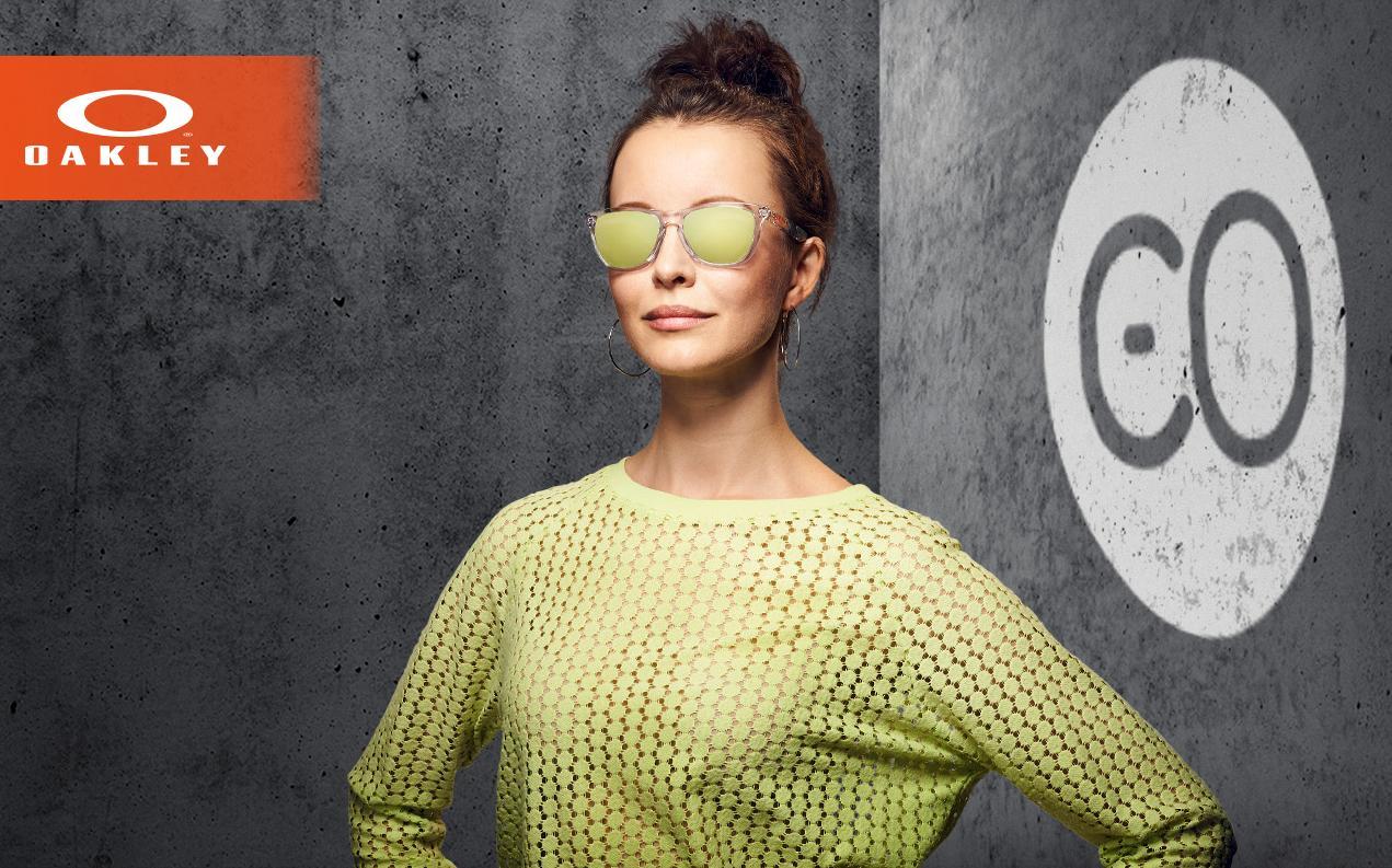 Female model wearing Oakley women's sunglasses