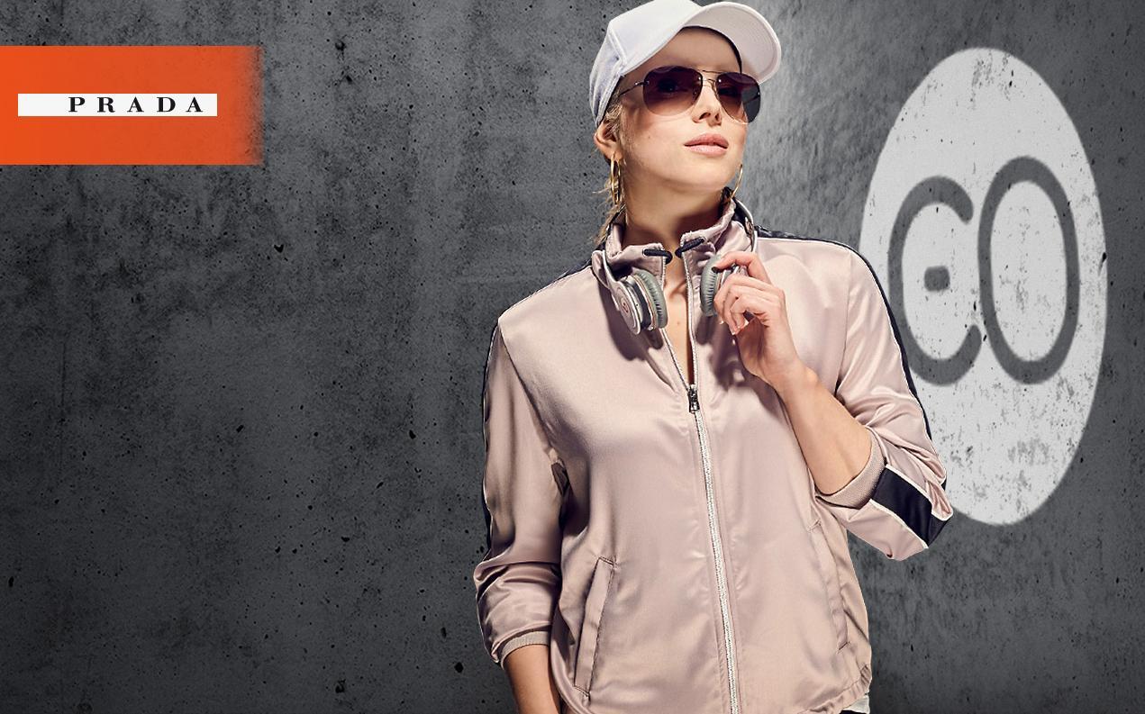 Female model wearing Prada sport women's sunglasses